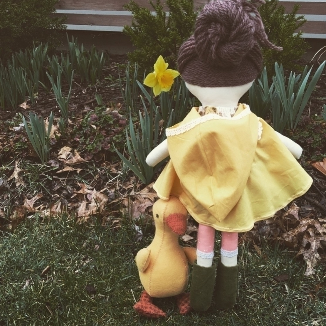 Make-Along doll playing in the rain with her pet duck